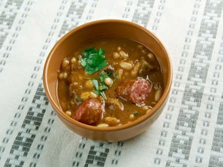 by cu: Fasole cu carnati - beans with sausages.  popular Romanian dish, consisting of baked beans and sausages.