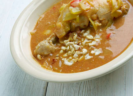 kwanzaa: Groundnut Soup -  West Africa Spicy Chicken Peanut Soup .  popular Ghanaian soup Stock Photo