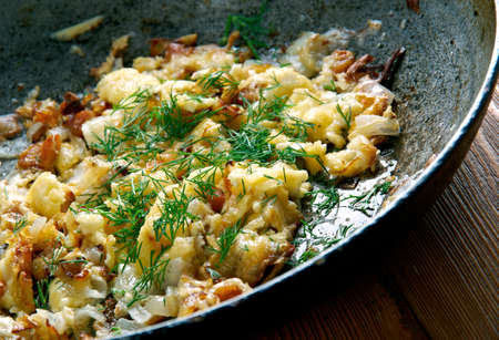 austrian: KasNocken - Austrian Spaetzle with cheese and caramelized onion. Stock Photo