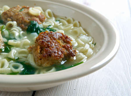 consisting: Italian wedding soup. Italian-American soup consisting of green vegetables and meat.