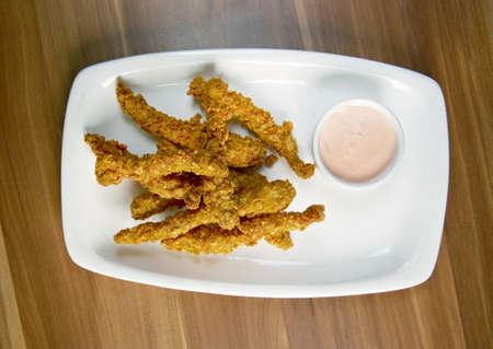 flavorsome: chicken fried croquettes on white platter Stock Photo