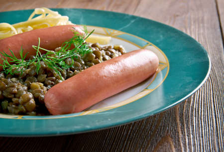swabian: Linsen mit Spatzle - lentils with Swabian pasta.accompanied with wiener sausages, is a traditional Swabian dish