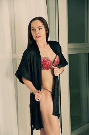 studio b: Sporty sexy girl on the background of bright studio in fitness bikini