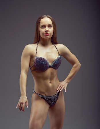 studio b: Woman with perfect athletic body in bikini
