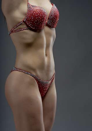 studio b: Female bodybuilder with solid defined abs  . fitness bikini