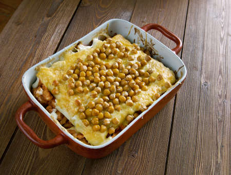 algerian: Hot Algerian Lasagna with chicken and chickpeas.African cuisine