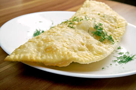 peoples: Cheburek  with meat- traditional Caucasian dish.national dish of the Crimean Tatars and  Caucasian and Turkic peoples,  popular  Transcaucasia, Central Asia, Russia, Ukraine,  in Turkey and Romania. Stock Photo