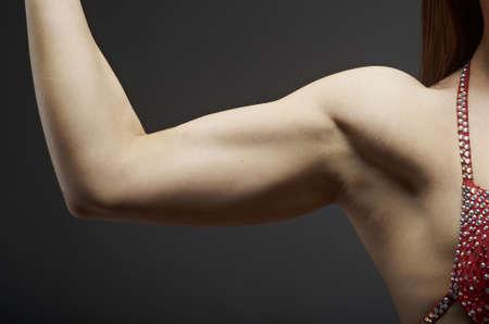 studio b: woman posing her muscular hands . fitness bikini Stock Photo