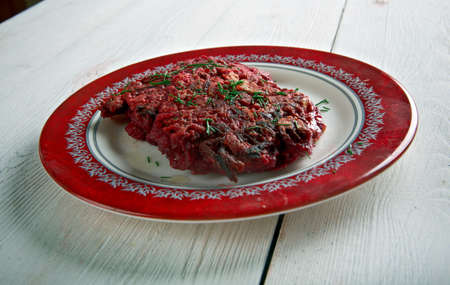 fritters: Beet Fritters on a wooden surface. traditional  german cuisine