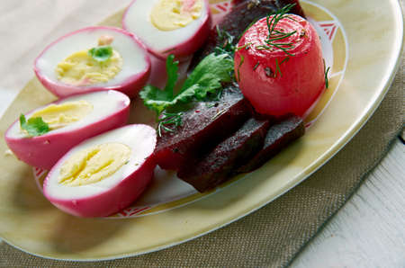 brine: Pennsylvania Dutch Pickled Beets and Eggs.hard boiled eggs that are cured in a brine of beets. Cuisine of the Midwestern United States.