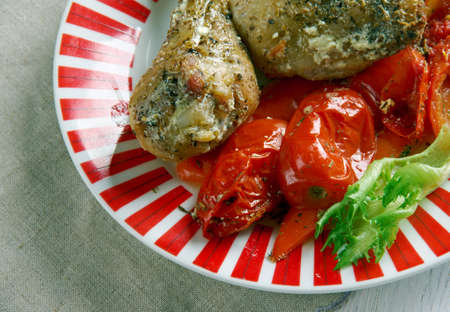 azerbaijani: Azerbaijani  Poached chicken with pickles and tomatoes - Toyuq soyutması Stock Photo