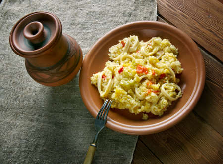 marisco: Paella with squid, pumpkin and sweet peppers Stock Photo