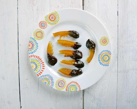 french cuisine: Orangette - candied orange in dark chocolate. French cuisine.