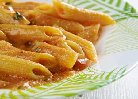 peperoni: Penne ai peperoni e prosciutto. close up Stock Photo