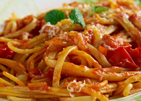 pasta sauce: Spaghetti allamatriciana. traditional Italian pasta sauce. Originating from the town of Amatrice. Stock Photo