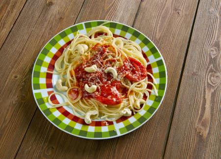 Spaghetti alla corsara - Italian pasta with tomato sauce and cashew nuts Stock Photo
