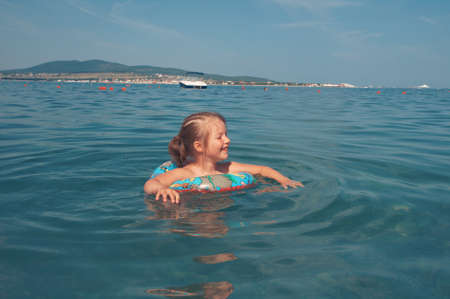 ittle: ittle girl on the beach. Black Sea coast