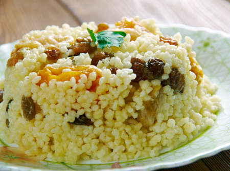 bil: Sweet couscous Bil Zbib.Algerian dessert with berries and fruits