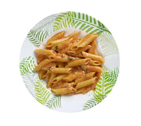 crema: Penne ai peperoni e prosciutto. close up Stock Photo