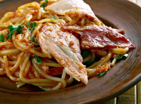 olio: Spaghetti allamatriciana with bacon.traditional Italian pasta sauce Stock Photo