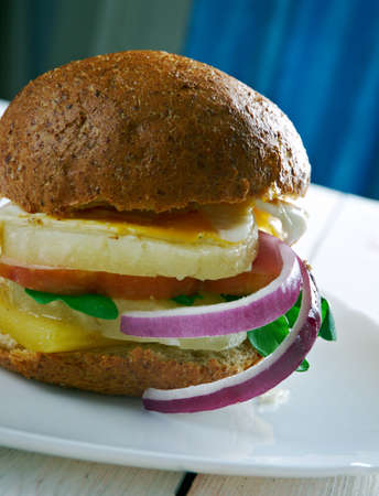 aussie: Aussie Burger Australians  burgers are cooking, BBQ the bacon and pineappl Stock Photo