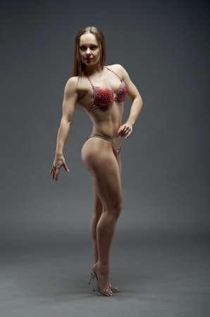 studio b: Woman with perfect athletic body . fitness bikini Stock Photo