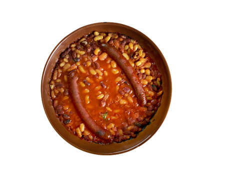 macedonian: Tavche gravche traditional Macedonian dish.Baked beans with sausage Stock Photo