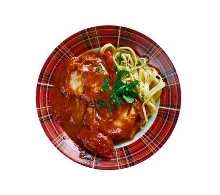 river fish: halaszle  paprika-based river fish soup . dish of Hungarian cuisine Stock Photo