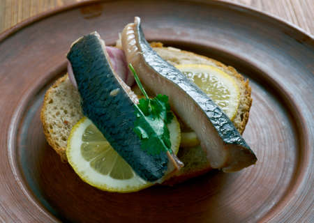 be soaked: Soused herring-  herring soaked in a mild preserving liquid. It can be raw herring in a mild vinegar pickle or Dutch brined herring