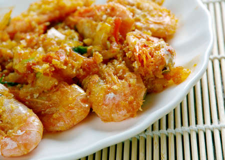 blanketed: Shrimp DeJonghe  specialty of Chicago, is a casserole of whole peeled shrimp blanketed in soft, garlicky, sherry-laced bread crumbs Stock Photo
