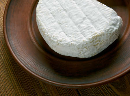 brie: Round Brie cheese - soft cows milk cheese named after Brie, the French region