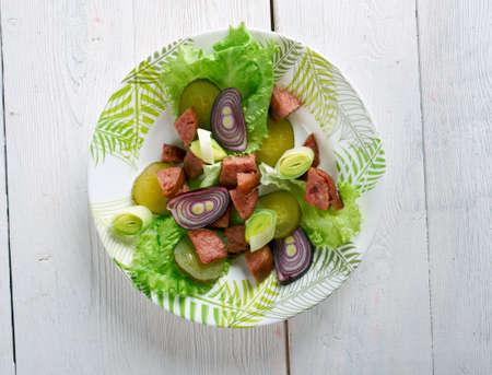 german sausage: Schwabischer Wurstsalat - German sausage salad. tart sausage salad prepared with distilled white vinegar, oil and onions.