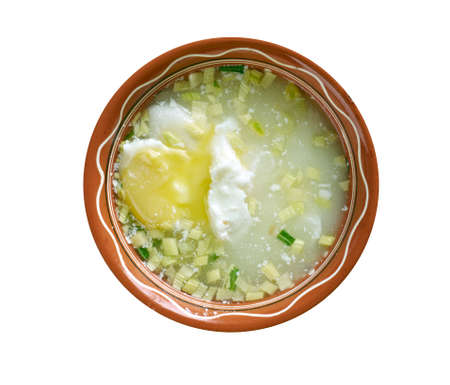colombian food: Changua con Huevo Colombiana.Poached Egg Soup.Colombian cuisine Stock Photo