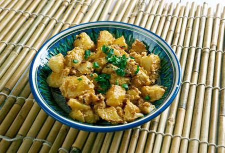 bengali: Aloo Posto -  Indian Bengali Potatoes with Poppy Seeds Stock Photo