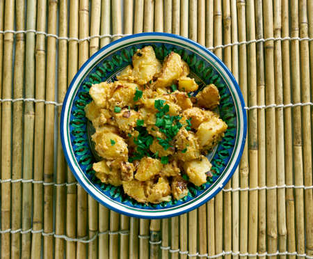 indian cookery: Aloo Posto -  Indian Bengali Potatoes with Poppy Seeds Stock Photo