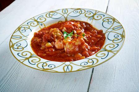 sopa: Sopa de Peixe com tomate. Fish Soup with Harts . Portuguese Food.Selective focus.