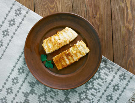 cypriot: Grilled  Halloumi -  Cypriot semi-hard, unripened brined cheese. popular in the Levant, Greece and Turkey Stock Photo