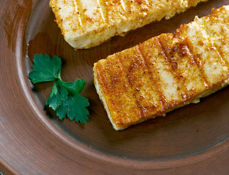unripened: Grilled  Halloumi -  Cypriot semi-hard, unripened brined cheese. popular in the Levant, Greece and Turkey Stock Photo