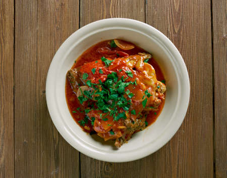 fine legs: Chicken Marengo -  French dish consisting of a chicken  oil with garlic and tomato.