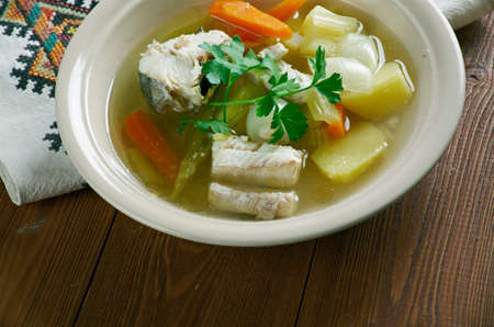 sturgeon: Russian fish soup - royal Ukha. with cod and sturgeon in the chicken broth