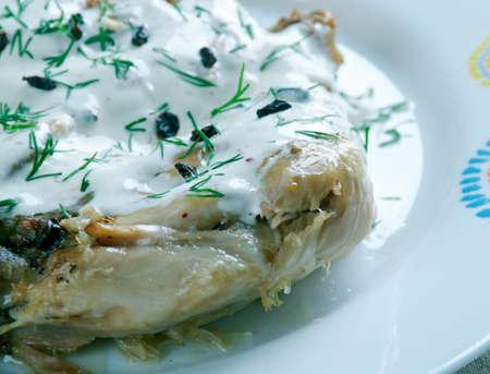 georgian: chkmeruli chicken -  traditional Georgian dish of chicken in garlic cream sauce.
