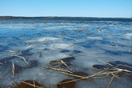 thin ice: Russian  landscape Arkhangelsk Oblast . spring flooding on the lake,Thin ice on the water