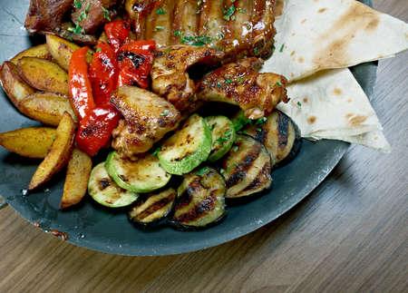 the shish kebab: Shashlik  - shish kebab. Various types  mat roasted with vegetable closeup