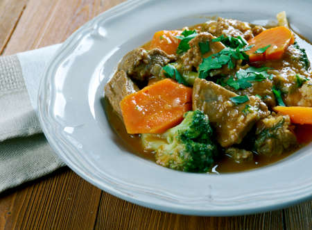 dark beer: Rindfleisch Altbiereintopf -  German traditional beef stew with carrots, dark beer Stock Photo