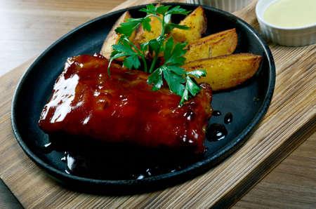 caramel sauce: Grilled caramelized pork ribs in caramel sauce. close up Stock Photo