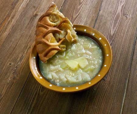 mit: Quetschekuche mit Grumbeersupp - German potato soup with pie