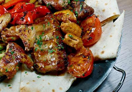 the shish kebab: Shish Kebab. Various types  mat roasted with vegetable closeup
