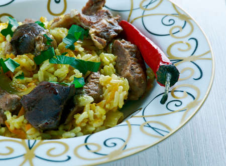 libyan: Ruzz bil Khaloot - Libyan rice with liver and almonds.African cuisine