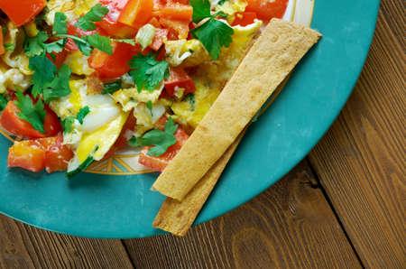 tortilla de maiz: Migas Tex-Mex cuisine - migas is a traditional breakfast dish consisting of corn tortilla strips fried on a pan or griddle until almost crispy and then eggs. Foto de archivo