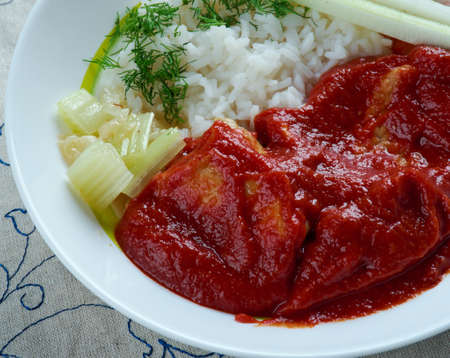 cerdo: Chileajo de cerdo dish originating from Oaxaca, Mexico.pork boiled in water and cooked in a thick sauce made of toasted guajillo chil Stock Photo